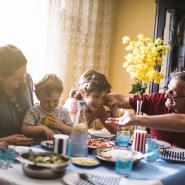 family eating at kitchen table